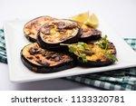 pan fry crispy baigan  ... | Shutterstock . vector #1133320781