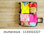 open suitcase fully packed with ... | Shutterstock . vector #1133322227