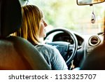 young girl in the car while...   Shutterstock . vector #1133325707