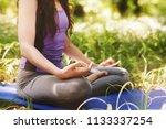 woman do yoga outdoor. woman... | Shutterstock . vector #1133337254