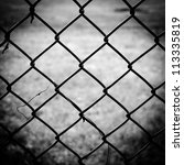 iron wire fence isolated abstract black and white - stock photo