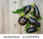 ripe eggplants on a wooden... | Shutterstock . vector #1133359901