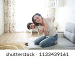 beautiful brunette mom and son... | Shutterstock . vector #1133439161