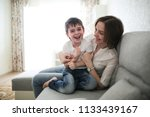 beautiful brunette mom and son... | Shutterstock . vector #1133439167