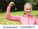 mature woman outside | Shutterstock . vector #1133448371