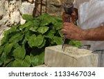 stonecutter chopping stone