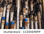 oil drill pipe. rusty drill... | Shutterstock . vector #1133469899