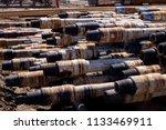 oil drill pipe. rusty drill... | Shutterstock . vector #1133469911