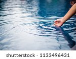the hand that touches the blue... | Shutterstock . vector #1133496431