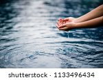 the hand that touches the blue... | Shutterstock . vector #1133496434