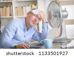 man suffers from heat while... | Shutterstock . vector #1133501927