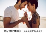 young happy couple outdoors... | Shutterstock . vector #1133541884