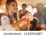 beautiful young woman driving a ... | Shutterstock . vector #1133541887