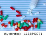 many pills are scattered on a... | Shutterstock . vector #1133543771