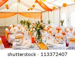 An image of tables setting at a ...