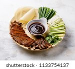 sliced peking duck served with... | Shutterstock . vector #1133754137