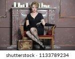blonde in black gloves armed... | Shutterstock . vector #1133789234