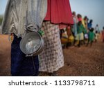 food queue in africa  hungry... | Shutterstock . vector #1133798711