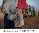 food queue in africa  hungry... | Shutterstock . vector #1133798711
