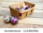 Basket with the bulbs of hyacinths on a wooden table - stock photo