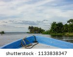 a boat on a lake nearby the... | Shutterstock . vector #1133838347