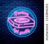 vintage pizza emblem glowing... | Shutterstock .eps vector #1133846201
