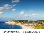 the seaside town of etretat ... | Shutterstock . vector #1133890571