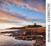dunstanburgh castle  now a ruin ... | Shutterstock . vector #1133891735