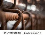 ceative view of rusty building... | Shutterstock . vector #1133921144