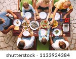 big family have a dinner with... | Shutterstock . vector #1133924384