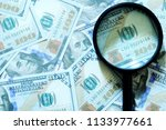 financial concept. magnifying... | Shutterstock . vector #1133977661