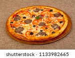 pizza with minced meat and... | Shutterstock . vector #1133982665