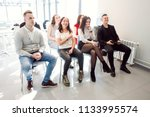 audience listening to speaker... | Shutterstock . vector #1133995574