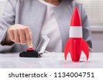 businesswoman's hand launching... | Shutterstock . vector #1134004751