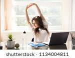 happy young businesswoman... | Shutterstock . vector #1134004811