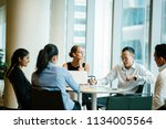 a diverse team of business... | Shutterstock . vector #1134005564