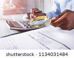 close up of a businessman... | Shutterstock . vector #1134031484