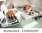 businessman's hand calculating... | Shutterstock . vector #1134031547