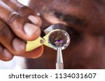 close up of jeweler examining... | Shutterstock . vector #1134031607
