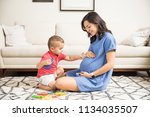 innocent boy touching abdomen... | Shutterstock . vector #1134035507