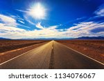 long road in blue cloudy sunny...   Shutterstock . vector #1134076067