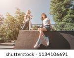 two female skaters friends... | Shutterstock . vector #1134106691