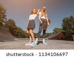 two female friends standing on... | Shutterstock . vector #1134106697