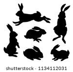 Stock vector rabbits set black silhouettes of hares in different poses isolated on white background vector 1134112031