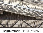 Small photo of Afternoon shadows of riverboat gangplank on wooden pier, Savannah, Georgia, USA, for motifs of parallelism and alternation, weather, tourism