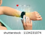 hand with smartwatch and... | Shutterstock . vector #1134231074
