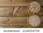 raw and cooked quinoa on a... | Shutterstock . vector #1134253754