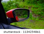 side mirror of a car while... | Shutterstock . vector #1134254861