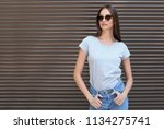 young woman wearing gray t... | Shutterstock . vector #1134275741