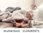 a cup of tea on a wooden table  ... | Shutterstock . vector #1134282071